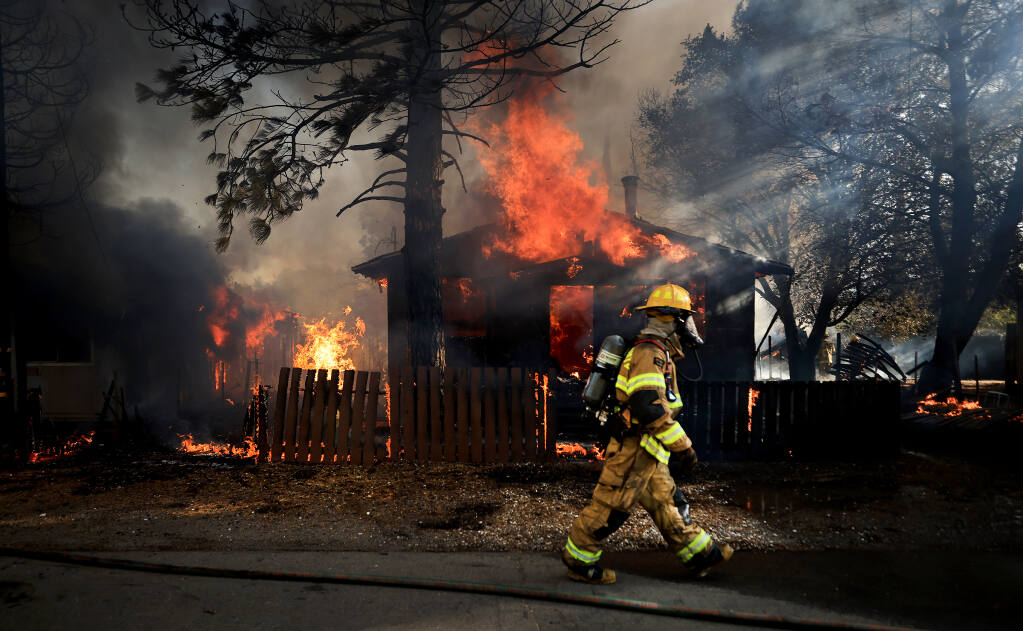 Firefighters from around Lake County converged on a fire that burned five homes in Clearlake Oaks, Sunday, July 18. 2021.  (Kent Porter / The Press Democrat)