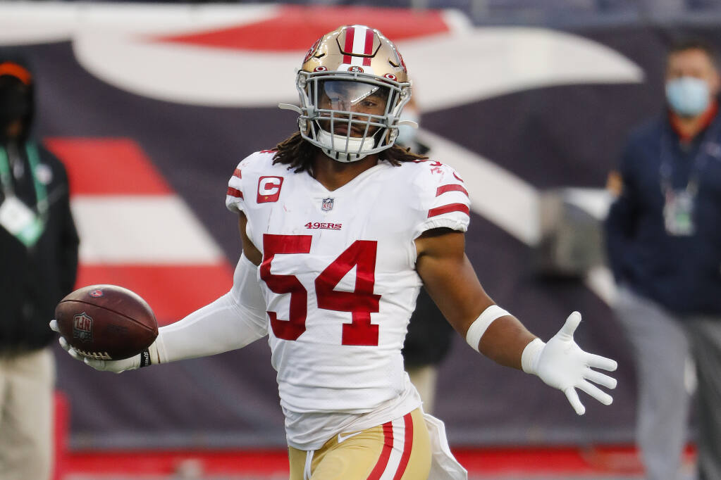 San Francisco 49ers linebacker Fred Warner returns an interception for a touchdown against the New England Patriots at Gillette Stadium on Sunday, Oct. 25, 2020 in Foxborough, Massachusetts. (Winslow Townson / ASSOCIATED PRESS)