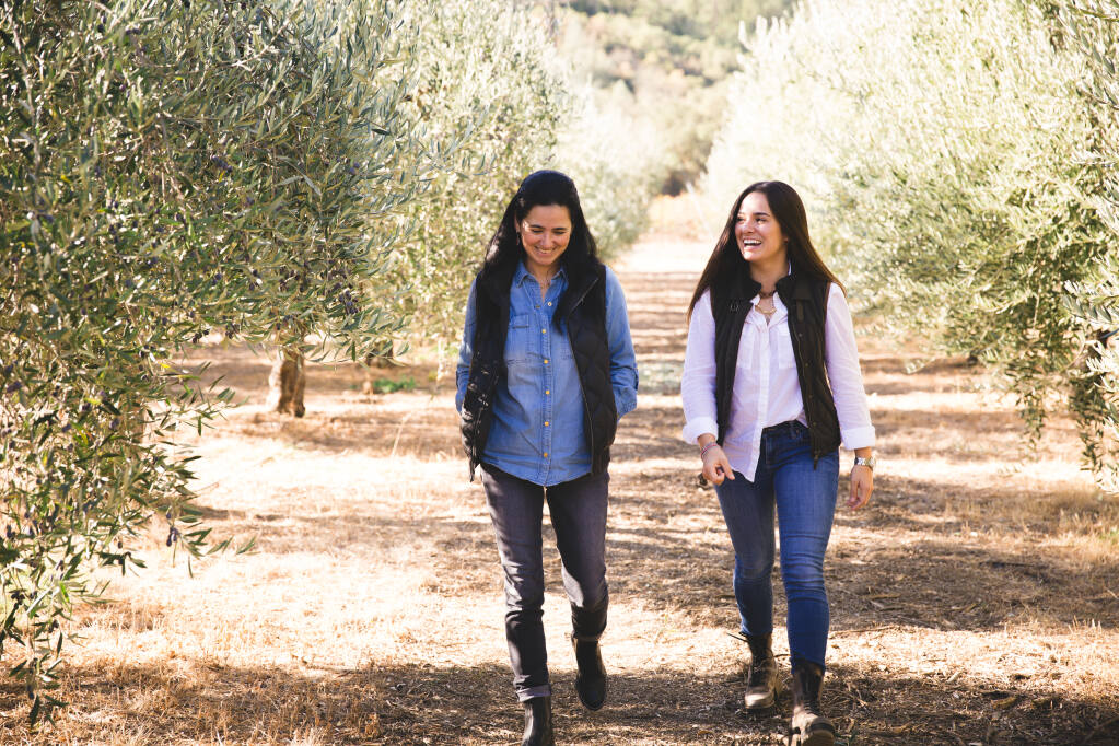 Mother-daughter team, Ana and Marcela Hernandez, walk the grounds of their Grove 45 Olive Oil farm in St. Helena. (Margaret Nissen photo)