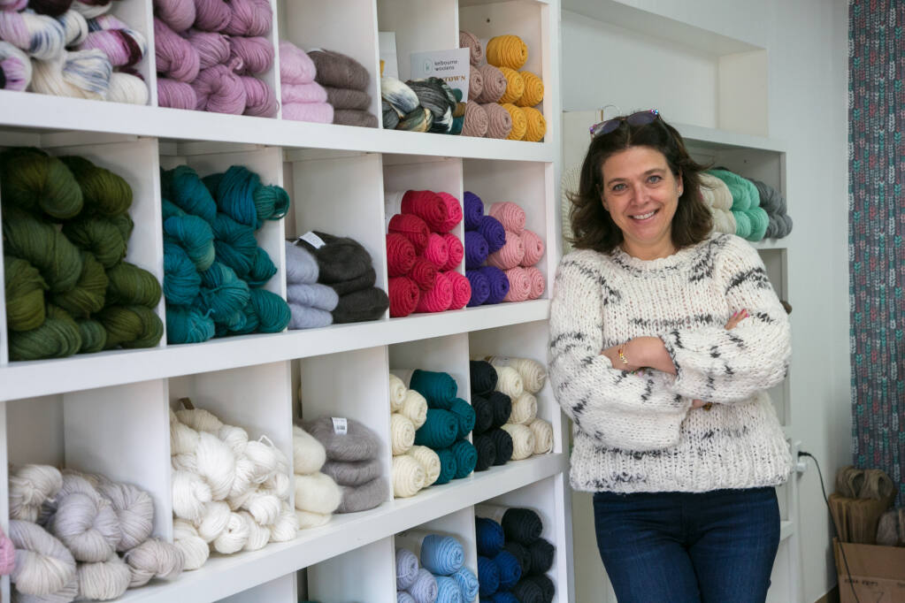 Marie Utnehmer in her yarn and community knitting store, Noma Knits at 730 W. Napa St. on  Feb. 17. She is wearing a hand-knit sweater, of course. (Photo by Julie Vader/special to the Index-Tribune)