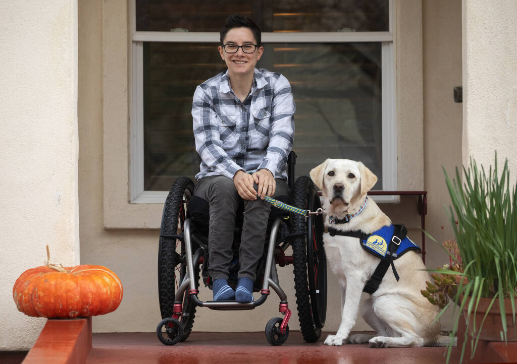 Wallis Brozman and her dog Renata work for and graduated from Canine Companions for Independence in Santa Rosa. Brozman lobbied for a new rule limiting emotional support animals on flights with the same free rein as trained service animals. Photo taken on Friday, Dec. 11, 2020.  (John Burgess/The Press Democrat)