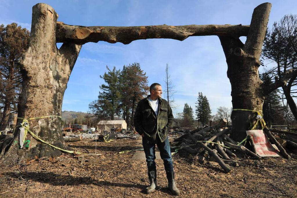 Houston Evans Jr., in front of his childhood home off Dennis Lane, Friday Dec. 29, 2017 where his mother, Valerie Evans, perished in the Tubbs fire in October. (Kent Porter / The Press Democrat) 2017