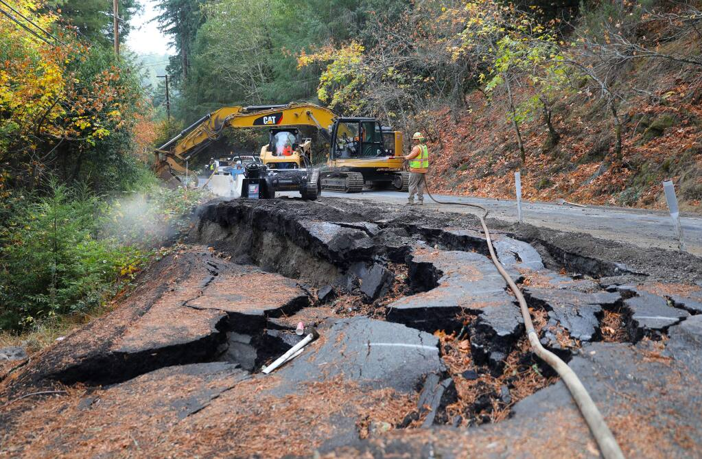 A construction crew works on repairing a section of Coleman Valley Road that was damaged during last winter's storms, near Occidental on Wednesday, November 13, 2019. (Christopher Chung/ The Press Democrat)